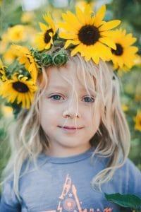 Child wearing a DIY sunflower crown.