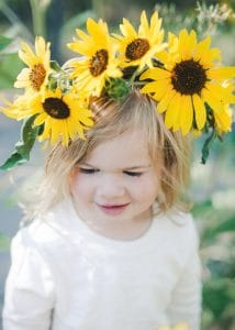 Child wearing a DIY sunflower crown.