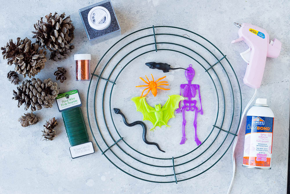 All the materials needed to make these Halloween Pinecone Wreaths