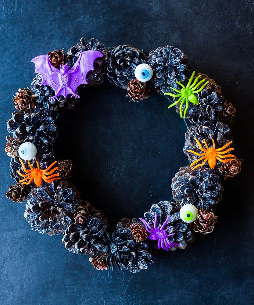 Halloween Pinecone Wreath on a black background