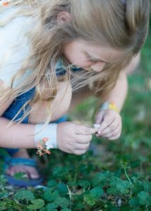 Picking flowers for nature bracelets.