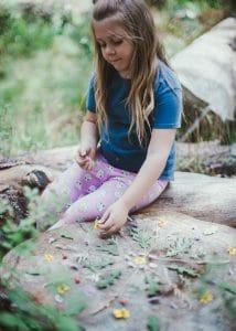 Child creating a nature mandala.