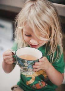 Boy drinking wild rose hip tea.