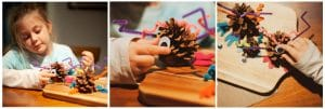 Child creating a pinecone monster.