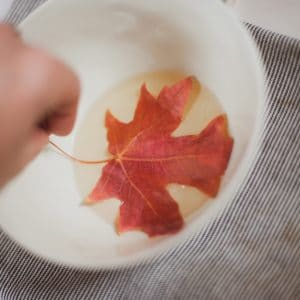 Dipping fall leaves into wax.