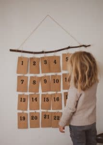 Child looking at an activity advent calendar.