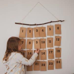 Child and an activity advent calendar.