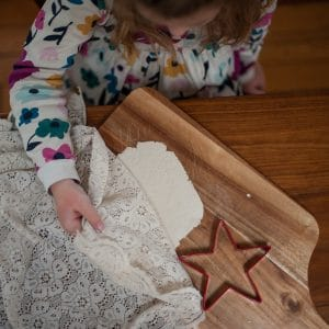 Child examining the lace pressed clay.