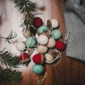Pile of felt acorn ornaments.