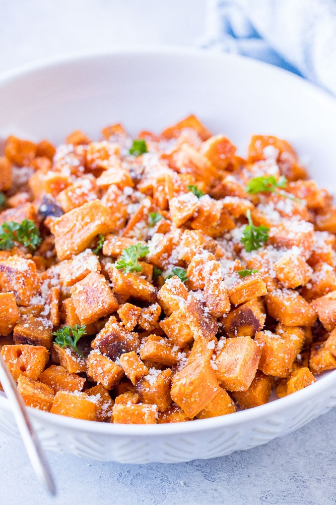 Close up of a bowl of Parmesan Roasted Sweet Potatoes