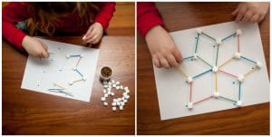 Child creating a small complex marshmallow snowflake.
