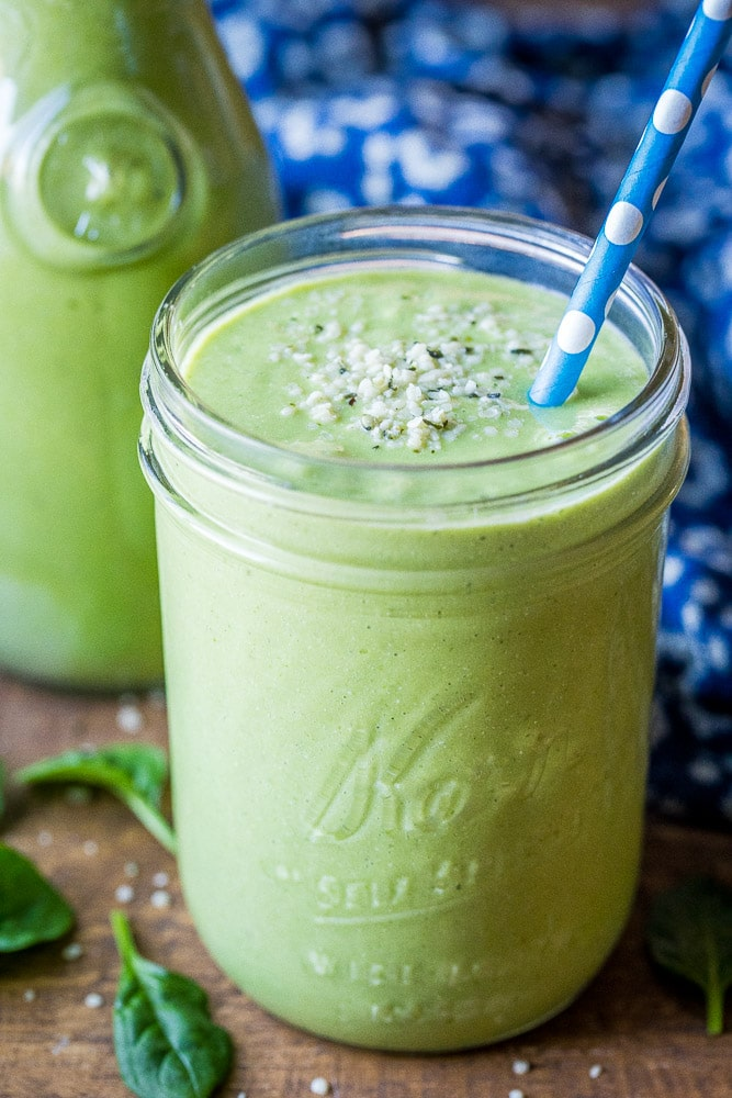 Green Smoothie in a glass with a blue straw