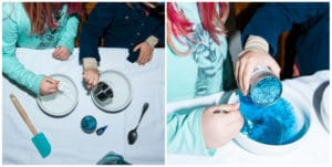 Children mixing ingredients to make wintery slime.
