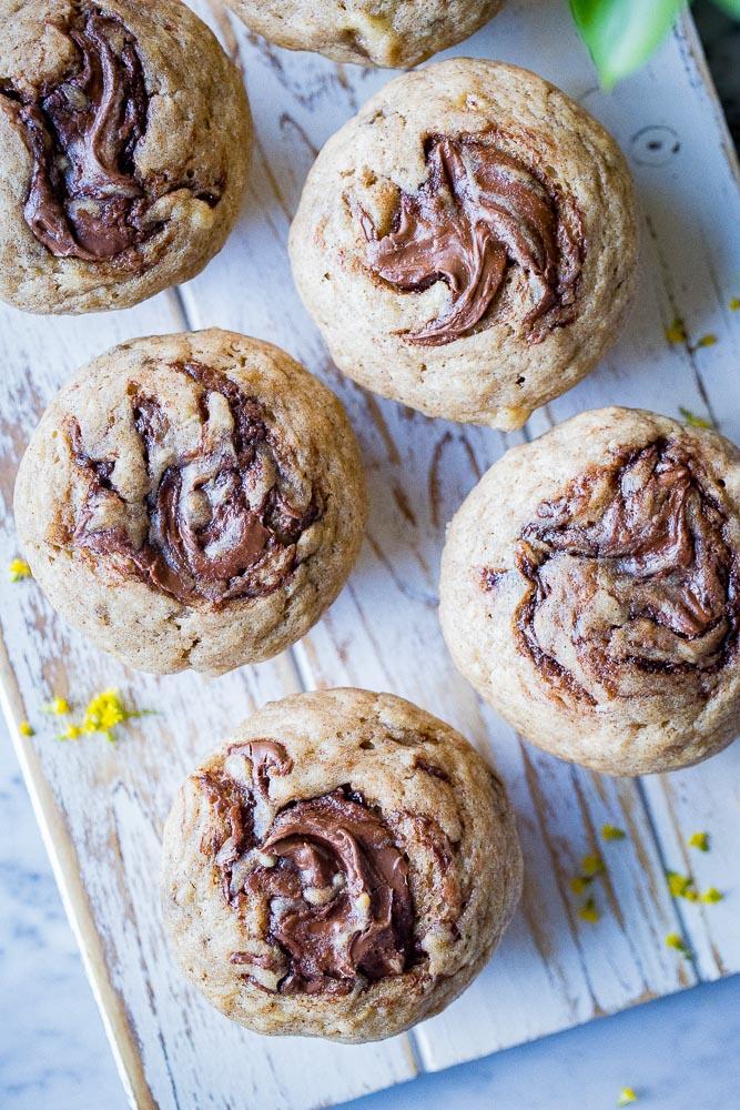 A plate full of nutella swirl banana muffins
