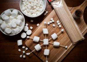 Supplies needed for marshmallow snowflakes.