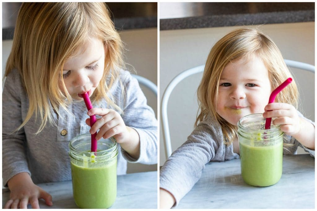 Child drinking a green smoothie