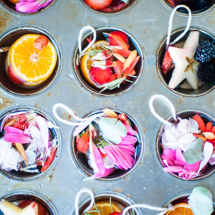 Material arranged in a muffin tin to make ice ornaments.