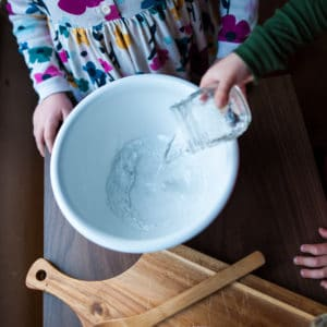 Pour water into a large bowl.