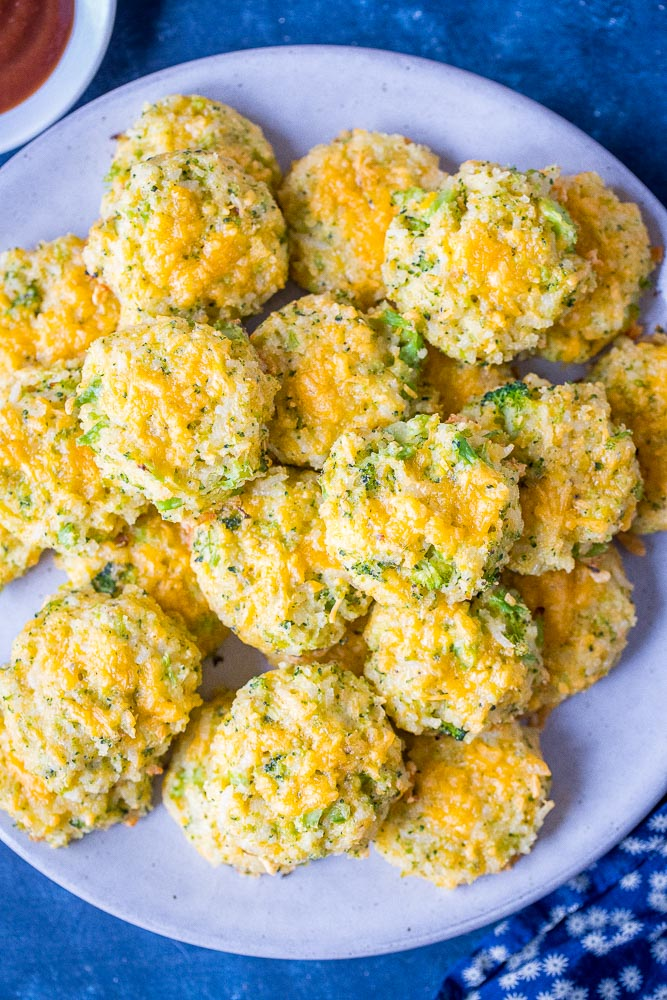 Big plate of broccoli rice casserole bites with ketchup