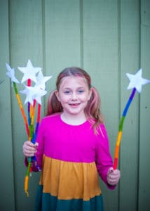 Girl playing with Rainbow Wands.