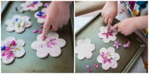 Press flowers into clay shapes to decorate.