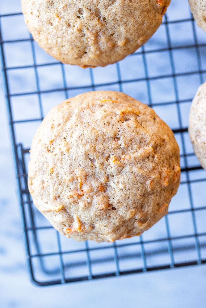 Carrot cake muffin cooling on a rack