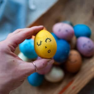 Add faces to your naturally dyed eggs.
