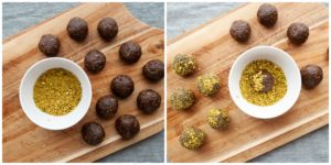 Coating chocolate and pistachio energy balls with pistachios.