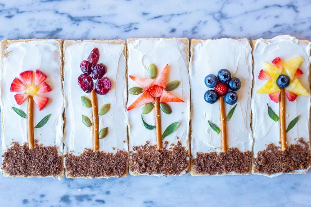 Flower garden graham crackers next to each other on a marble table