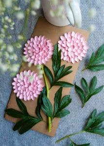 Dahlias made with spray painted pistachio shells.