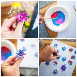 Stamping flowers on paper to make fireworks.