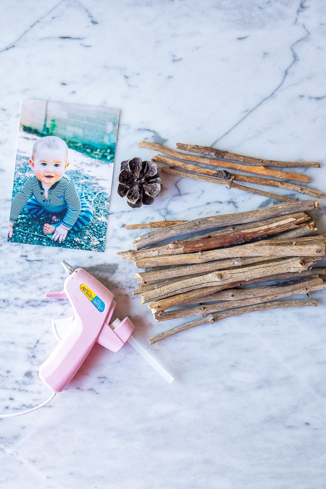 Showing how to make a twig picture frame with the materials laid out