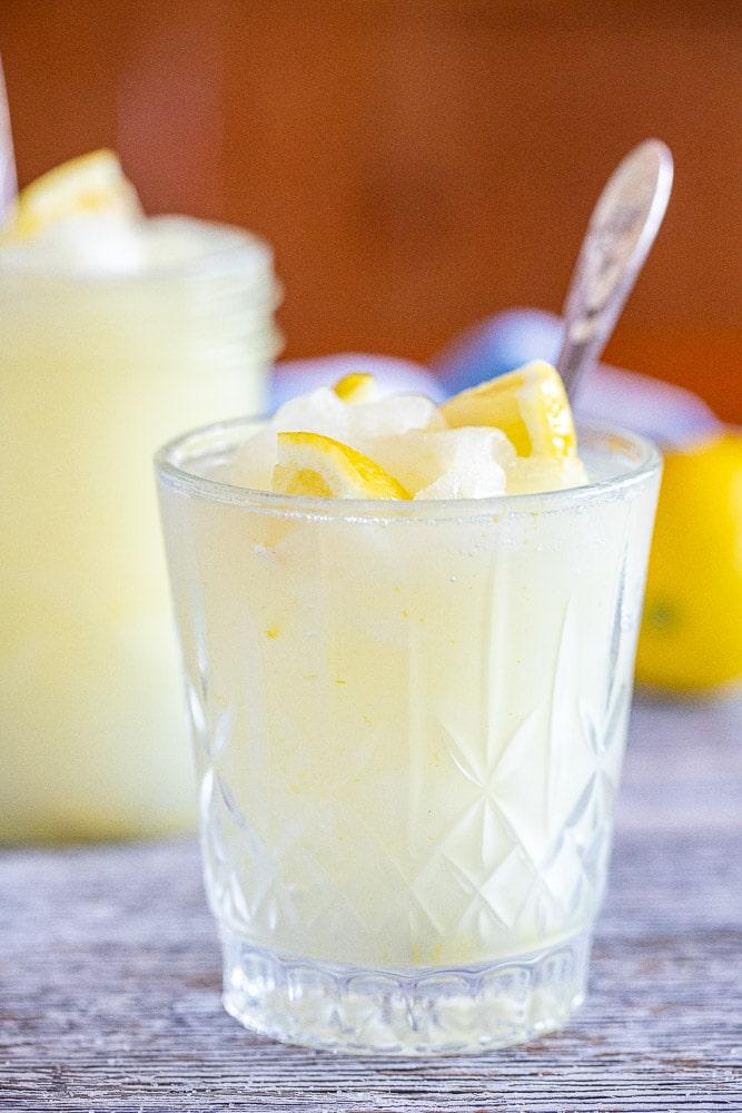 a glass of frozen lemonade with lemons in it
