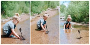 Child playing with a fairy boat in a stream.