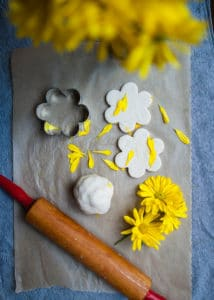 Homemade playdough decorated with flower petals.