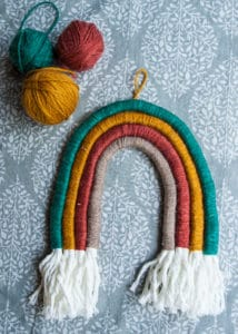 Completed macrame rainbow wall hanging.