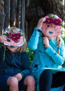 Children playing with woodland animal masks.