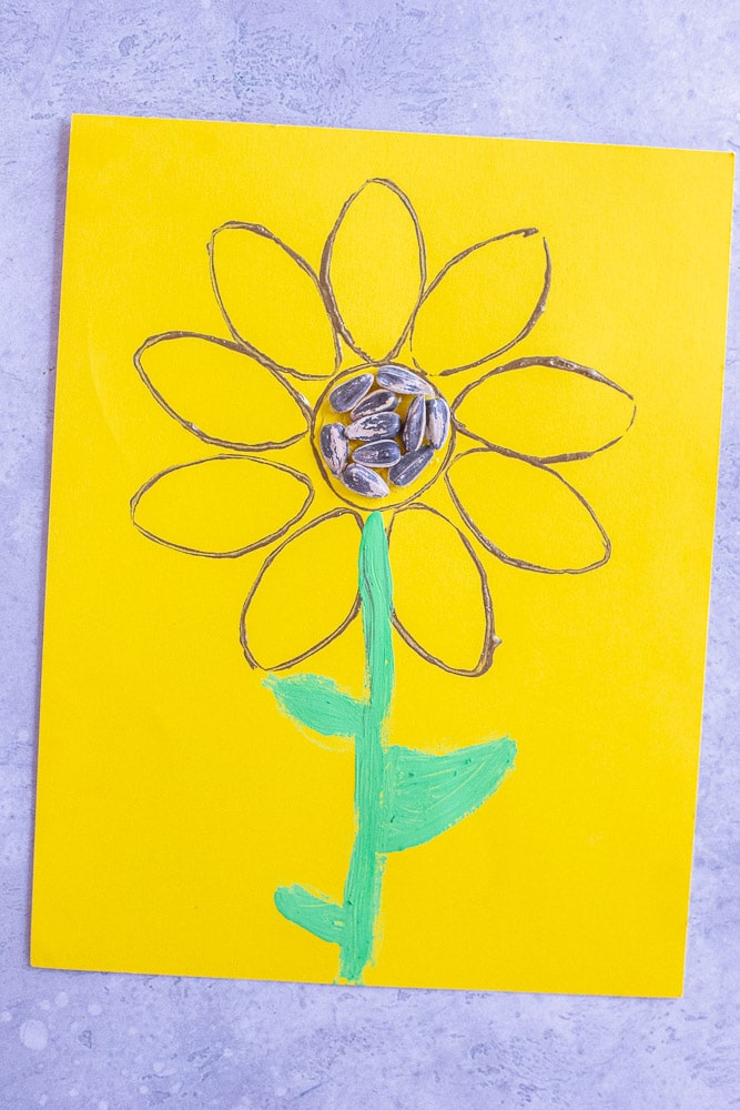 A sunflower painting made using a toilet paper roll