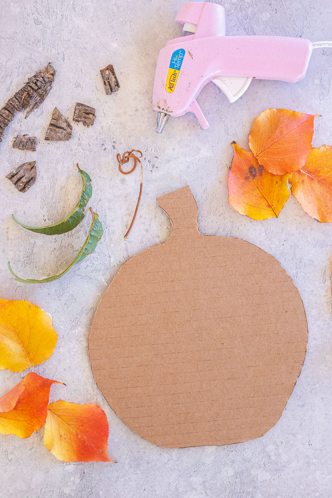 all the materials needed to make a fall leaf jack-lantern