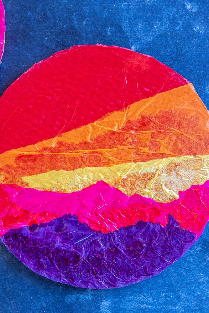 close up of a tissue paper sunset with different colors