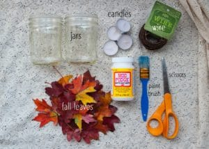Supplies and materials needed for making fall lanterns.