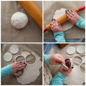 Child rolling out air dry clay.