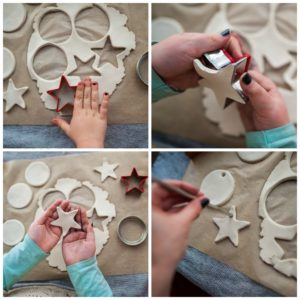 Child cutting out holiday shapes out of clay.