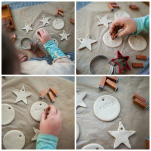 Child stamping peace, love, and joy into her clay ornaments.