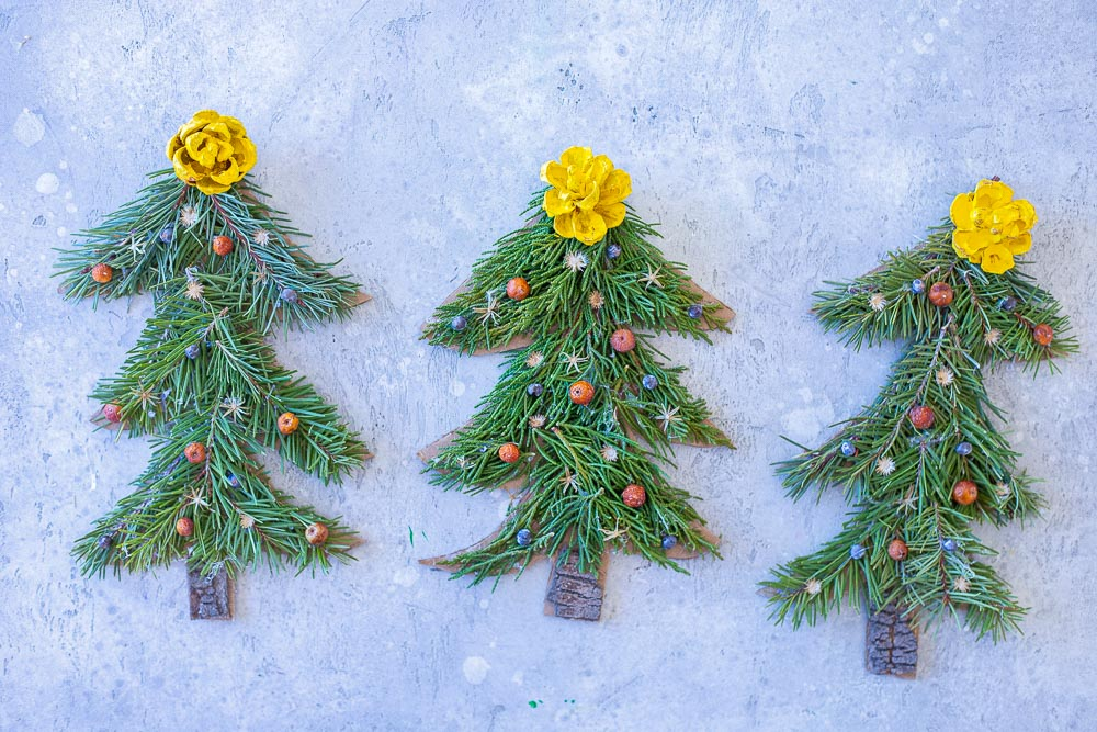 three Christmas tree crafts side by side