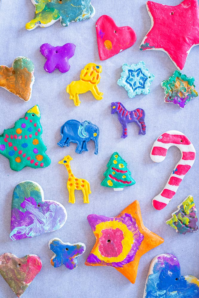 a tray of painted salt dough ornaments