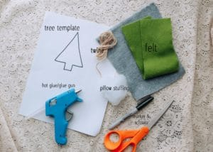 Materials needed to make no-sew felt Christmas ornaments.