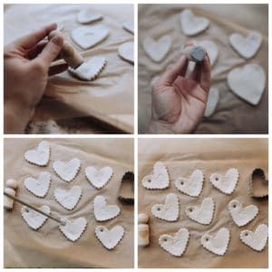 Person using a stamp to decorate Clay Hearts.