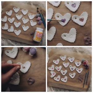 Child decorating Clay Hearts with paint and glitter.