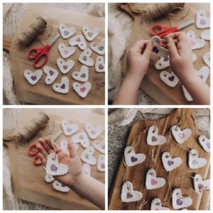 Child adding twine to the Clay Hearts to create an ornament.